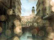 Calle Preciados bajo lluvia