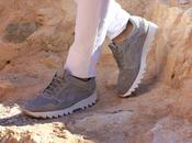 Grey sneakers, orange coat wood watch